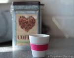 Espresso coffee cup with coffee tin
