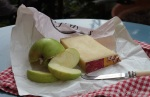 Apple slices and a piece of cheese